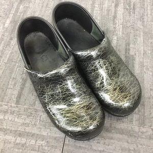 Dansko black silver patterned clogs